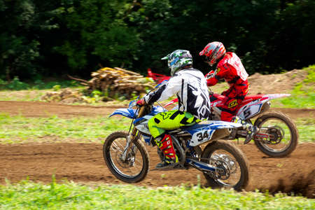 uzhhorod, ukraine - JUN 24, 2018: motocross riders in action. bikes in dirt and dust. extreme sports training