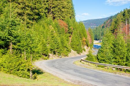 asphalt road through mountain valley. sunny weather, travel concept, beautiful nature scenery in autumn