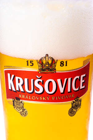 uzhgorod, ukraine - SEP 02, 2015: czech light beer. logo of a popular krusovice brand on a glass. white background Editorial