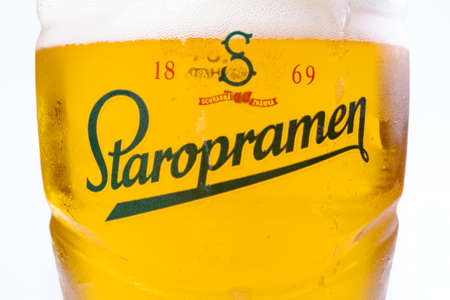 uzhgorod, ukraine - SEP 02, 2015: czech light beer. logo of a popular staropramen brand on a glass. white background