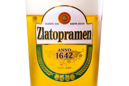 uzhgorod, ukraine - SEP 02, 2015: czech light beer. logo of a popular zlatopramen brand on a glass. white background
