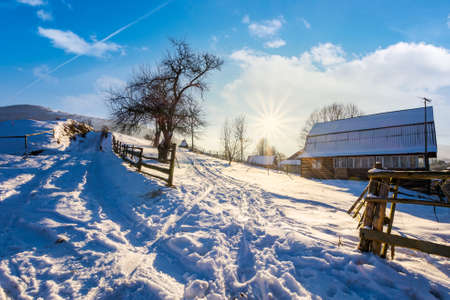 lovely winter scenery of Carpathian village. lots of snow on a sunny day in mountainous area