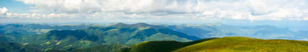 mountain panorama on a summer day. hills rolling from the valley up in to the distance. view of the carpathian watershed ridge beneath a sky with clouds Stock Photo