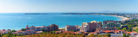 panorama of the sunny beach bay. popular destination of bulgaria. famous resort town nessebar on an island. mountain ridge in the far distance. velvet season