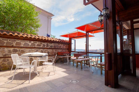 sozopol, bulgaria, - AUG 11, 2015: restaurant at the seaside. terrace with no visitors Editorial