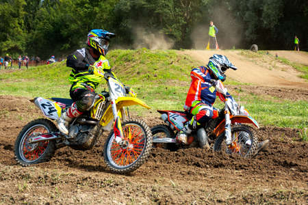 uzhhorod, ukraine - JUN 24, 2018: motocross riders in action. bikes in dirt and dust. extreme sports training