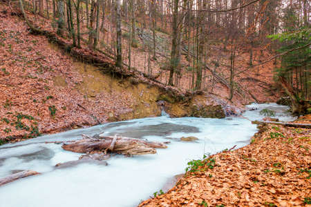 frozen river in the forest. cold frosty weather Stock Photo