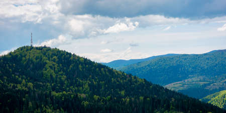 rolling hills of mountain landscape. cloudy day in carpathian mountains. ridge in the distance. beautiful nature background in springtime Stock Photo