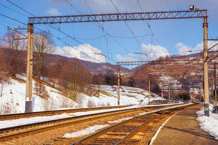 railway station in mountains. frosty winter landscape. transportation scenery Stock Photo
