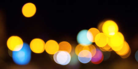 winter holidays background. garlands on the street with bokeh effect Stock Photo