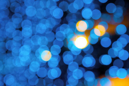 blue blurry Christmas lights on the streets. holiday night background with bokeh effect.