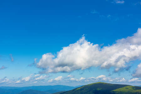 white fluffy clouds on the blue sky. beautiful nature scenery in mountains Stock Photo