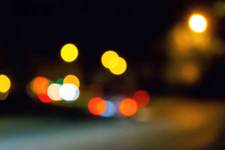 traffic light on the night streets. urban background with bokeh effect Stock Photo