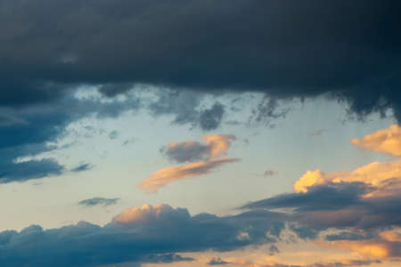 glowing clouds on evening sky. beautiful nature background Stock Photo
