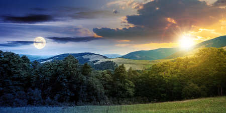 day and night time change concept above summer mountain landscape. beautiful scenery with sun and moon. beech forest and grassy alpine meadows on the hills. clouds on the gorgeous sky