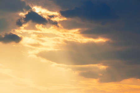 clouds in dramatic evening light. warm yellow nature background Stock Photo