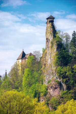 oravsky podzamok, slovakia - MAY 01, 2019: castle tower on the rock. beautiful sunny landscape in springtime. trees in green foliage on the meadow beneath a sky with clouds. popular travel destination Editorial