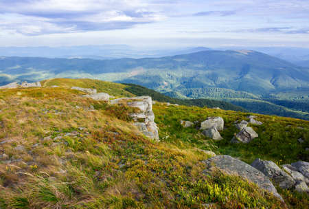 landscape of carpathian mountains. stones on the hill. view in to the distant valley. clouds on the sky in morning light. wonderful travel destination Stock Photo