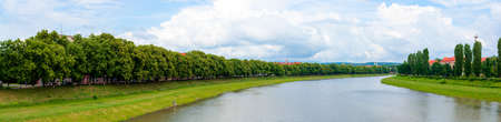 panorama of river uzh between linden and chestnut alleys on the nezalezhnosti and kyiv embankments. popular travel destination. beautiful urban scenery on a sunny day Stock Photo