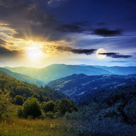 day and night time change concept above countryside landscape. beautiful nature scenery with meadows on the hills rolling in to the distant valley at twilight with sun and moon