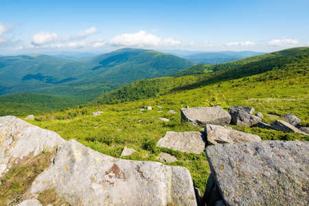 summer mountain landscape. stones on the hillside meadow. beautiful view in to the distant valley on a bright summer day. wonderful nature of carpathian mountains, ukraine Stock Photo