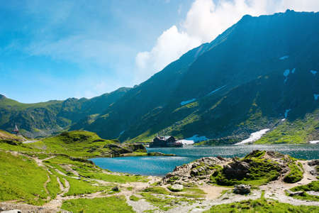 landscape of balea lake in fagaras mountains. wonderful summer nature scenery in the morning. popular travel destination of romania Stock Photo