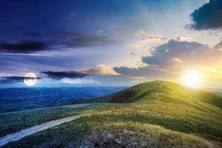 day and night time change concept above the mountain landscape in spring. path through meadow in grass on the hill with sun and moon. wonderful weather with fluffy clouds on the sky Stock Photo