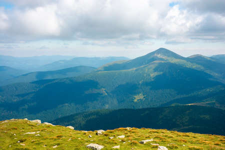 carpathian mountain landscape in summer. hoverla peak and chornohora ridge in the distance. cloudy afternoon weather