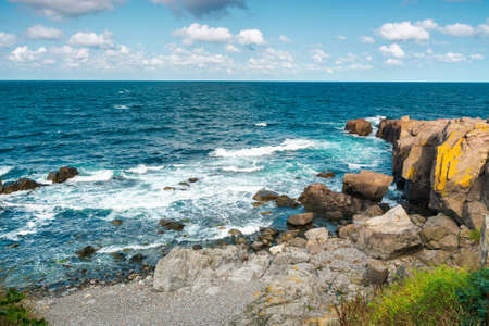 seascape of sozopol, bulgaria. wonderful scenery with cliffs in evening light. sunny weather with clouds above horizon. popular travel destination in summer Stock Photo