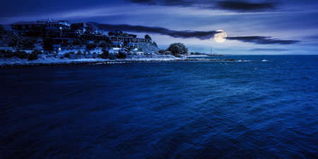 old resort town at night. beautiful scenery at the sea in full moon light