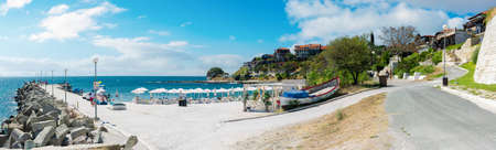 old town of nessebar, bulgaria. panorama of south beach with pier at high noon with clouds on the sky. popular travel destination