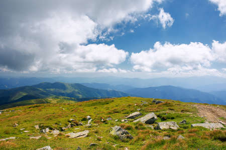 mountain landscape on a sunny day. beautiful nature background. gorgeous cloudscape above the mountain ridge with grassy meadows. travel back country concept