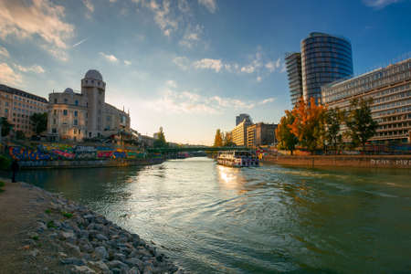 vienna, austria - OCT 17, 2019: cityscape of vienna with danube channel. beautiful urban scenery in evening light. gorgeous sky above the skyline Editorial
