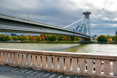 bratislava, slovakia - OCT 16, 2019: bridge through danube. sunny weather with clouds on the sky. cityscape of slovakian capital in autumn. view from the downtown side of the river Editorial