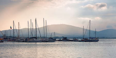 yachts and boats in port of sozopol, bulgaria. beautiful travel landscape with mountains on the sea shore in evening light Stock Photo