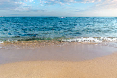 calm morning scenery at the sea. empty sandy beach in morning light. relax and summer vacation concept. sunny weather with clouds on the sky