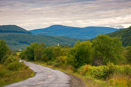 country road in early morning. beautiful mountain scenery in autumn Stock Photo