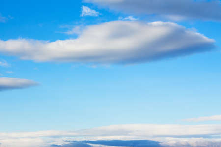 fluffy clouds on a blue sky. beautiful nature background in spring Stock Photo