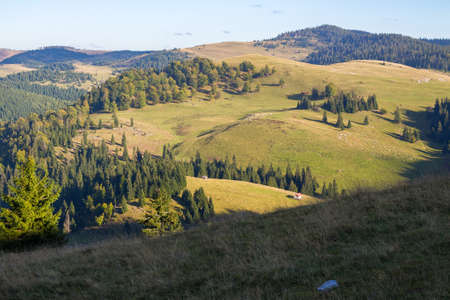 apuseni natural park of romania. landscape with forested rolling hills and valleys in evenign light. popular travel destination. beautiful nature scenery in early autumn Stock Photo