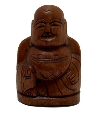 Isolated antique hand carved wooden Buddha figure on white background