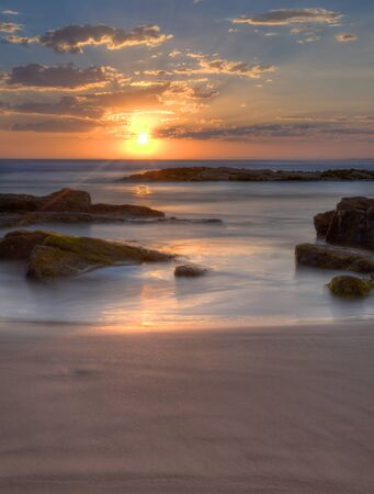 Sunset at Birubi Beach in NSW, Australia photo
