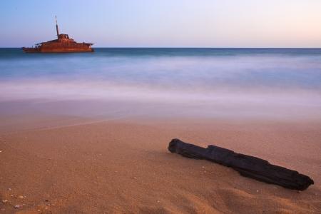 shipwreck on a beach at dusk