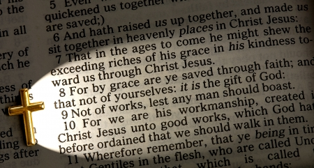 a close up of Ephesians 2 8 lit up by the cross, King James version photo