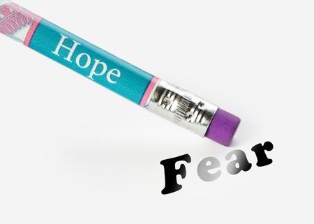 analog�a: concepto de esperanza de borrar la idea del miedo usando una analog�a del borrador Foto de archivo