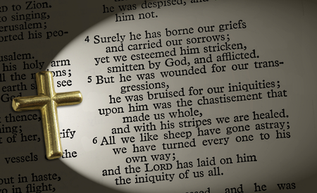 The bible passage Isaiah 53:4-6, lit up by the cross