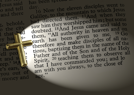 The bible passage Matthew 28:18-20, lit up by the cross Stock Photo