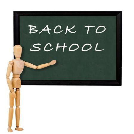 mannequin pointing to blackboard with the text back to school