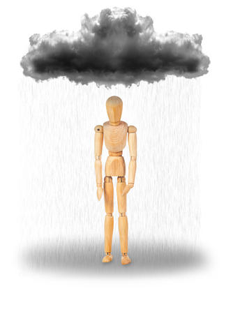 mannequin standing under a rain cloud, depicting sadness