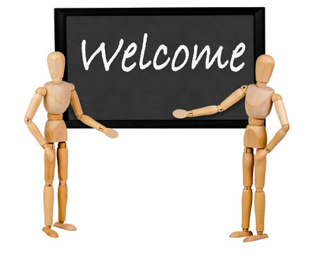 stating: two mannequins pointing to blank blackboard stating welcome Stock Photo