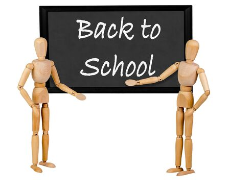 stating: two mannequins pointing to blank blackboard stating back to school Stock Photo